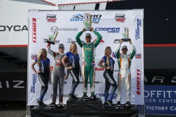 David Malukas, Rinus Veekay, and Carlos Cunha on the podium of the 2018 Pro Mazda Grand Prix of St. Petersburg